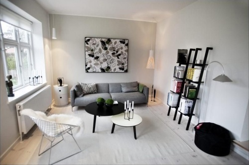 45-Amazing-Scandinavian-Living-Room-Designs-With-grey-couch-and-wooden-table-and-rug-and-window-and-cabinet-chair-and-wooden-floor