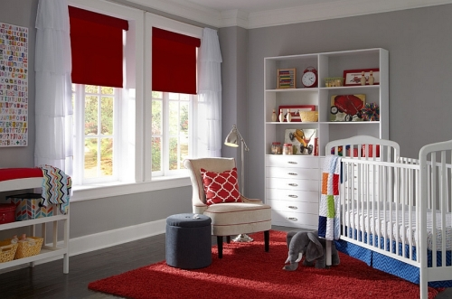 Red-Roman-shades-and-rug-in-the-nursery-keep-the-space-elegant-simple-and-lively